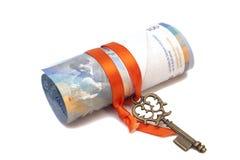 Note et clé de franc suisse au succès avec l'arc rouge Image stock