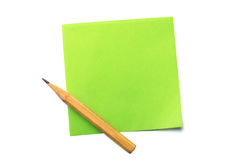 Note et crayon collants Photographie stock