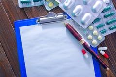 Note et pilules Image stock
