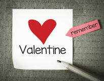 Note with 14 february. And pencil on grunge background Stock Photos