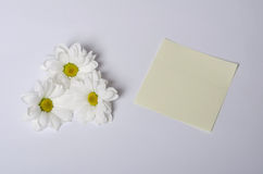 Note and flower Royalty Free Stock Photo