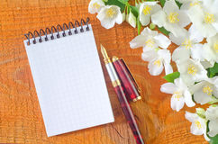 Note and flowers Royalty Free Stock Image
