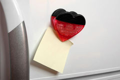 Note on the fridge. Blank yellow note with a heart on the fridge Royalty Free Stock Images
