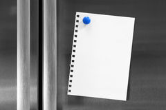 Note on Fridge with Magnet. Note for your text attached to fridge with fridge magnet stock photo