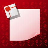 Note with gift on red christmas background Stock Photography