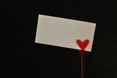 A note holder with a red heart with an empty card Royalty Free Stock Images