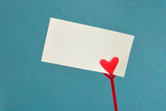 A note holder with a red heart with an empty card Royalty Free Stock Photo
