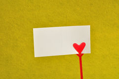 A note holder with a red heart with an empty card Stock Images