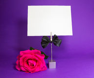 The note holder with rose and empty card Royalty Free Stock Image