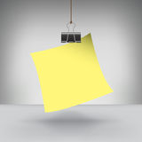 A Note Hung by a Binder Clip Royalty Free Stock Image