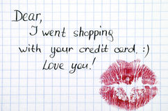 Note - I went shopping with  your credit card. with kiss Royalty Free Stock Image