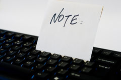 Note on keyboard Stock Photos
