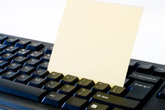 Note on keyboard Stock Photography