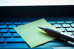 Note on Keyboard. Yellow note left on a black laptop keyboard Royalty Free Stock Photography