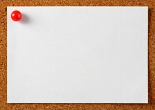Note memo paper with red pin. On cork board Royalty Free Stock Photos