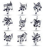 Note musicali nere e simboli isolati su bianco Fotografie Stock