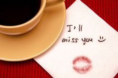Note on napkin. Ill miss you on the table with cup of tea or coffee Royalty Free Stock Photo