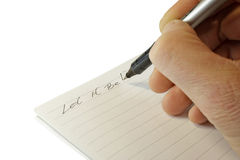 Note in a notebook. The casual phrase which has been written down in a notebook Stock Images
