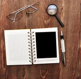 Note with old photo, pen and eyeglasses Stock Photos