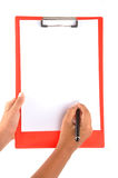 Note pad. Hand writing on the note pad on isolated background Royalty Free Stock Image