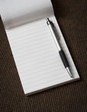 Note pad. Note pad with pen. Close up Stock Photography