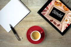 Note pad with ballpoint pen and tablet computer with sign Oktobe. Rfest and cup of coffee Royalty Free Stock Photos