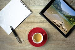 Note pad and ballpoint pen with tablet and picture of lake Vilsa. Lpsee in Austria Royalty Free Stock Images