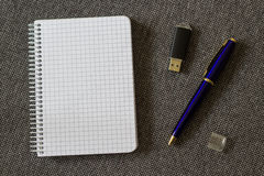 Note Pad with Blue Pen and Flash Drive. A series of photos with stationery items Royalty Free Stock Images