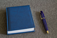 Note Pad and  Blue Pen. A series of photos with stationery items Stock Photos