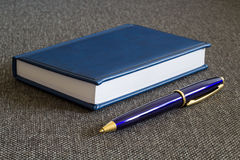 Note Pad and  Blue Pen. A series of photos with stationery items Royalty Free Stock Photography