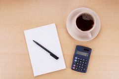 Note pad calculator and coffee Stock Photography