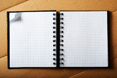 Note pad on cardboard. Stock Photo