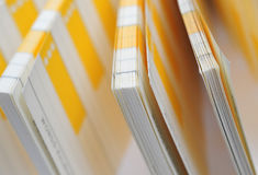 Note Pad and Document-Yellow Papers-Vertical View Stock Photos
