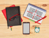 Note pad with drawing maze Stock Photo