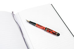 Note Pad and Fountain Pen. Lines note pad with fountain pen and ribbon place markers Royalty Free Stock Photography