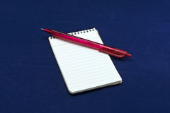 Note pad with green pencil red ballpen. A note pad with a red ballpen. For writing notes, lists, reminders or any kind of text. Also for making quick sketches Stock Images