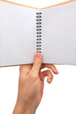 Note pad in hand Royalty Free Stock Photos