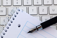 Note pad and keyboard of a computer Royalty Free Stock Photo