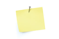 Note Pad And Nail. Yellow paper note pad attached with nail. Isolated on white with clipping path stock photos