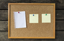 Note pad on notice board. Cork board with wooden frame and blank notepad, office notice board stock image