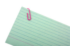 Note pad with a paper clip. On white background Stock Image