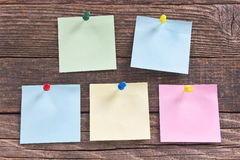 Note pad papers on wooden board Royalty Free Stock Photos
