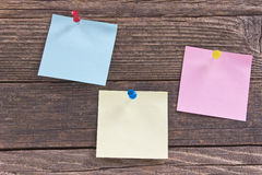 Note pad papers on  wooden board Stock Photos