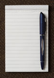 Note pad with pen. Top view stock photos