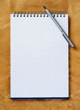 Note pad with pen. Close up Royalty Free Stock Image