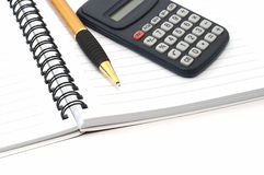 Note pad with pen and calculator Stock Photos