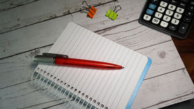 Note pad and pen. With calculator Royalty Free Stock Images