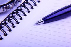 Note Pad and Pen. Close-up of pen and a notebook Stock Image