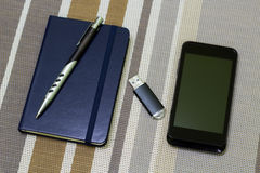 Note Pad, Pen, Flash drive and Mobile phone. A series of photos with stationery items Stock Photography