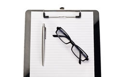 Note pad, pen and glasses Royalty Free Stock Images